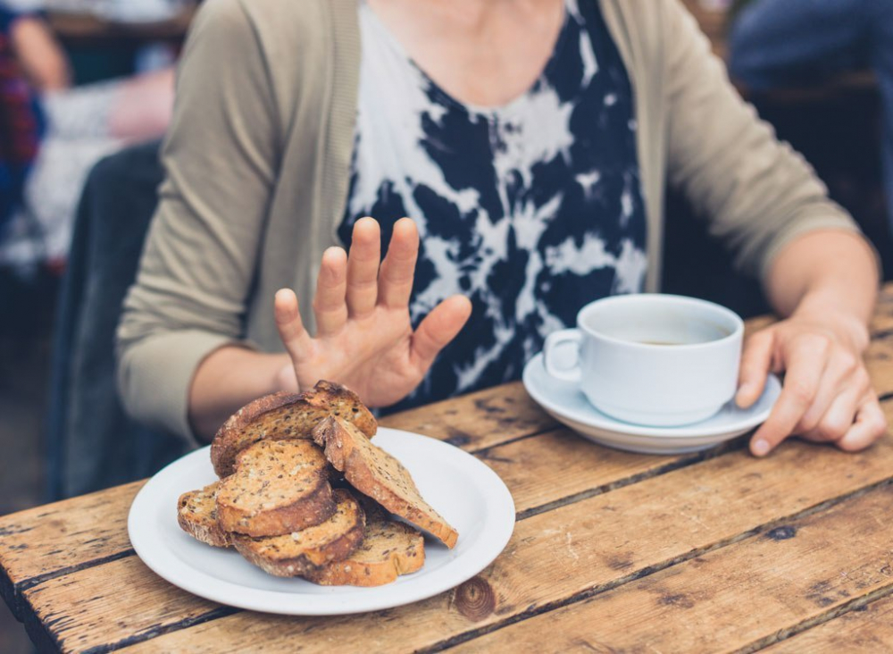 woman_saying_no_to_food_bread